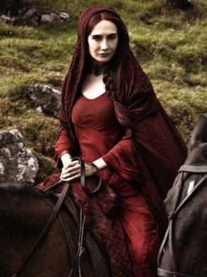 Melisandre from Game of Thrones wearing her signature red dress and cape