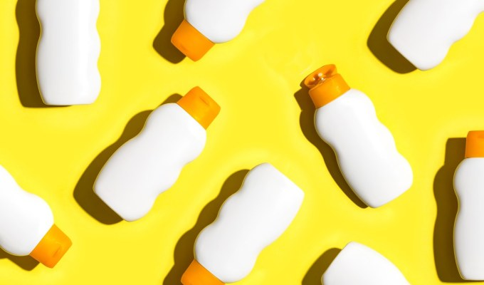 Picture of sunscreens on a yellow background