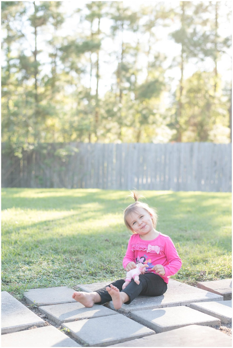 Kingwood child photographer images of daughter, Pumpkin for second birthday