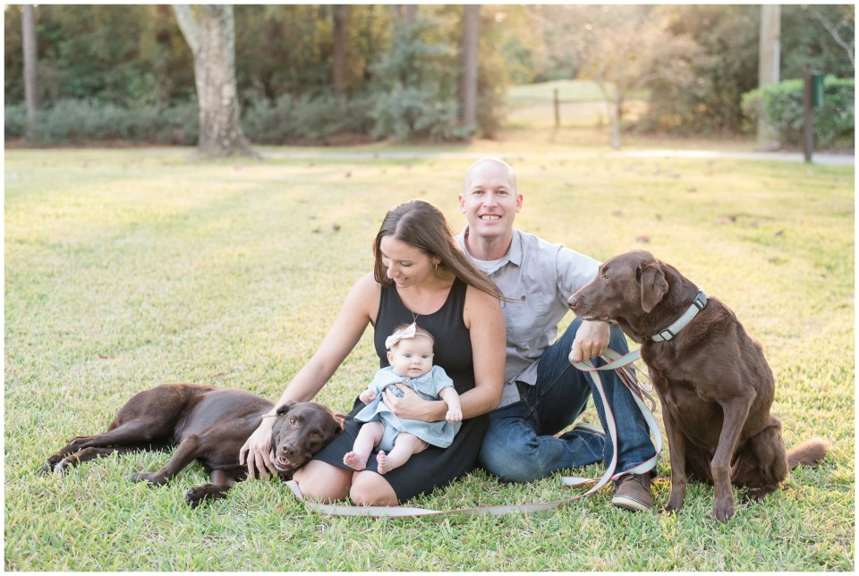 Kingwood photographer outdoor family portrait session with infant and two dogs