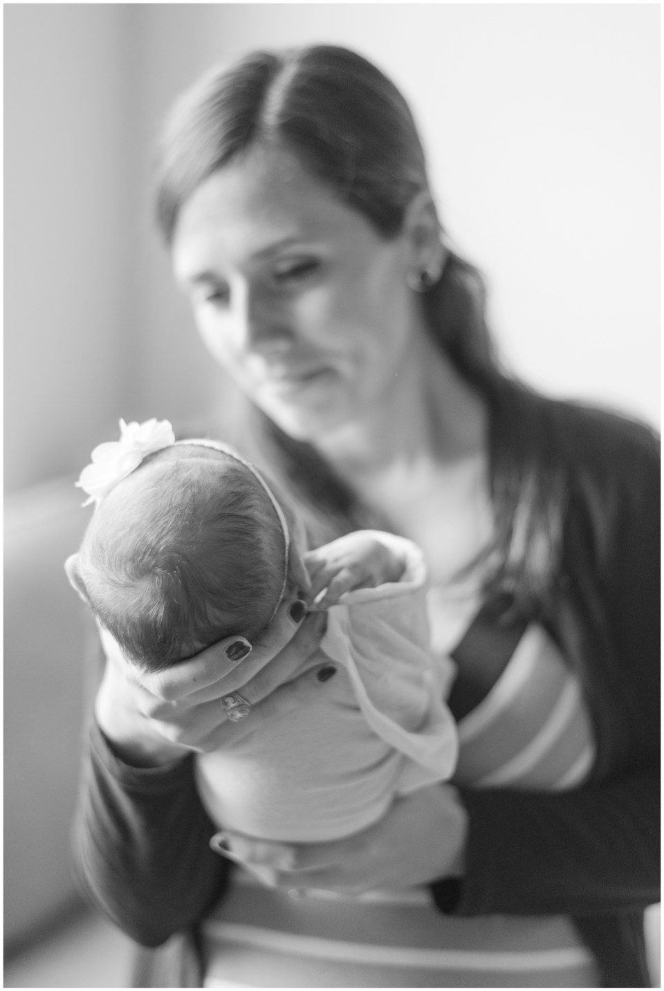 Kingwood family photographer images from an at-home newborn session with baby girl & her big sister