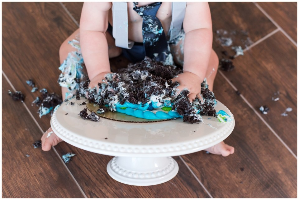 Houston photographer's 1 year portrait and cake smash session with milestone portrait client, JP