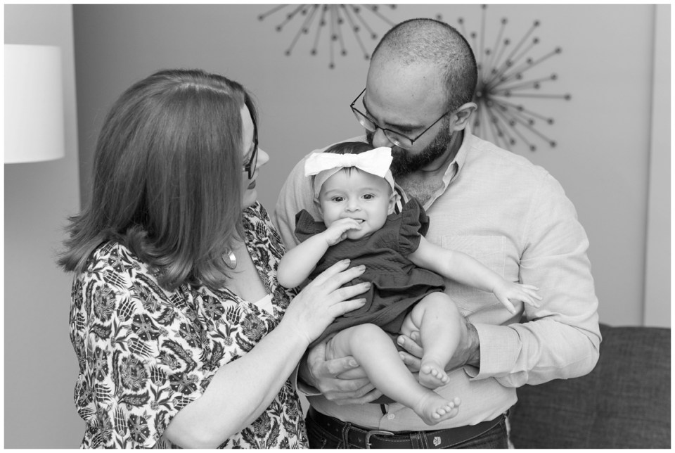 Houston photographer's 6 month milestone portrait session with baby girl and her parents in Atascocita, Texas