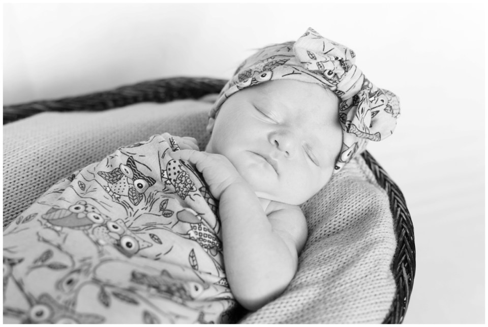 Houston photographer's at-home lifestyle newborn portrait session with Houston family and their new baby girl