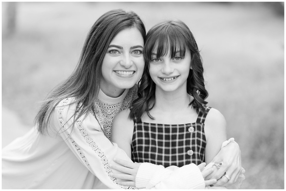 Kingwood family photographer mini session with family of three in natural, outdoor setting with yellow wildflowers