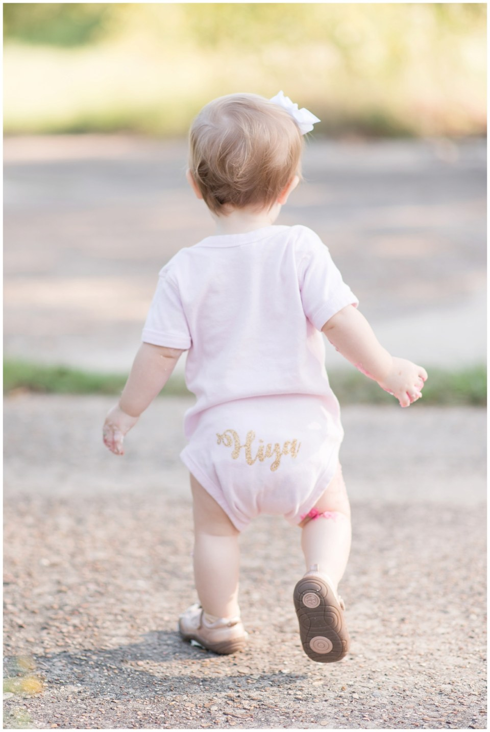 Kingwood photographer mini session with adorable 1 year old in polka dot tutu for cake smash