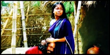 Rokeya prachi and mahmuduzzaman babu in the film Shopnodanay