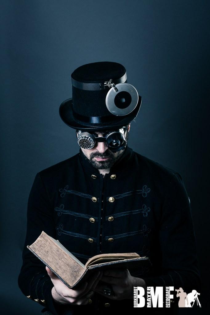 steam punk man reading