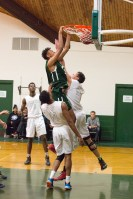 Isaiah Fontaine '16 dunks over opposition. Photo by David Barron.