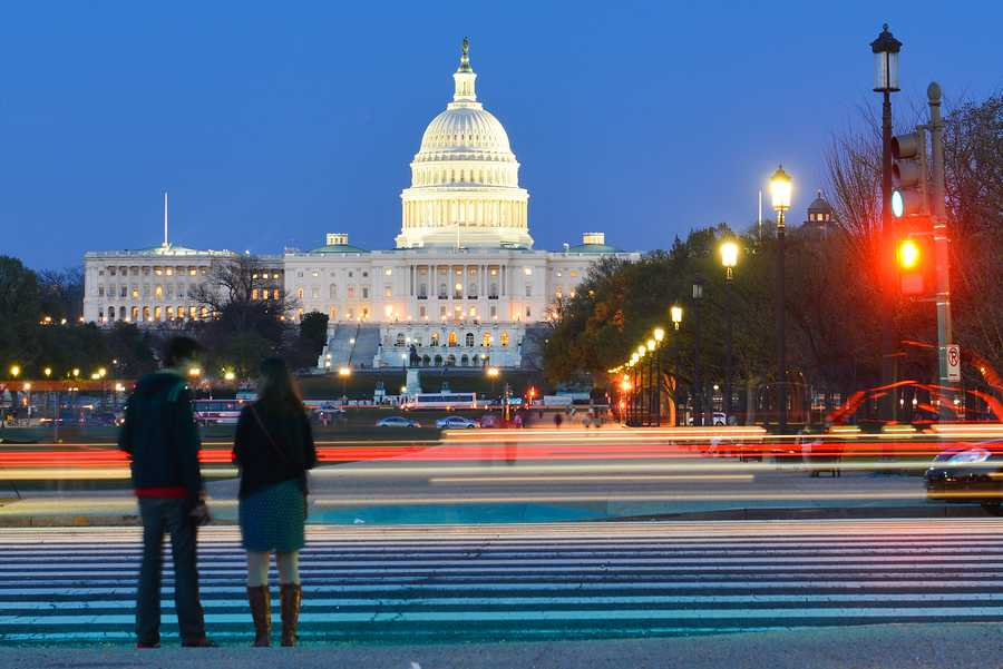 Washington+DC+-+US+Capitol+Building+with+car+lights+trails+foreground+at+night
