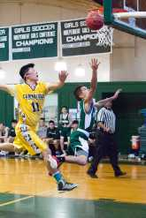 Jacob Quiles '16 passes a defender for two. Photo by David Barron.