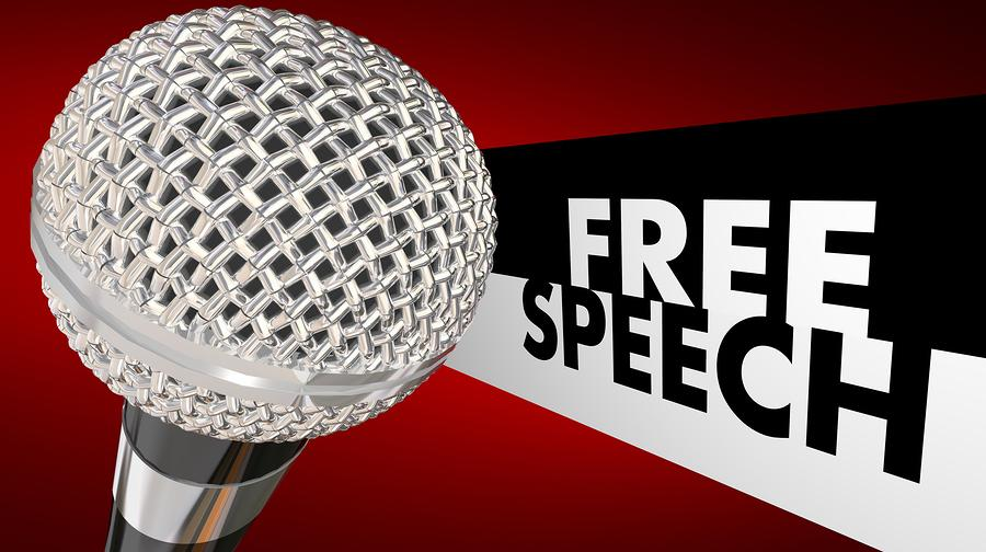 Free Speech words beside a 3d microphone to symbolize the first amendment and freedom of expression