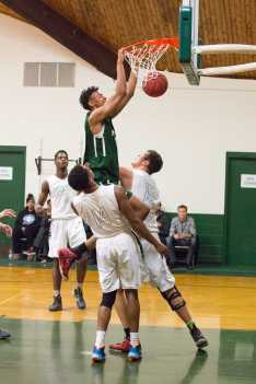 Photo by David Barron: Isaiah Fontaine '16 scores against defenders.