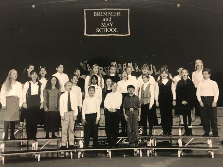In 1994, lower school students performed in front of the stage, which then existed in the gym, where the fitness center now lives. Photo courtesy of Brimmer and May. Can you spot Mr. Cutler?