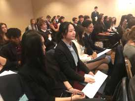 Yvonne Xi '18, who represented Ghana in SPECPOL, considers a resolution. Photo by David Cutler '02.