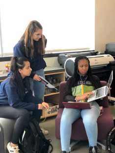 Stephanie Cranmore '21 explains an assignment to her peers.