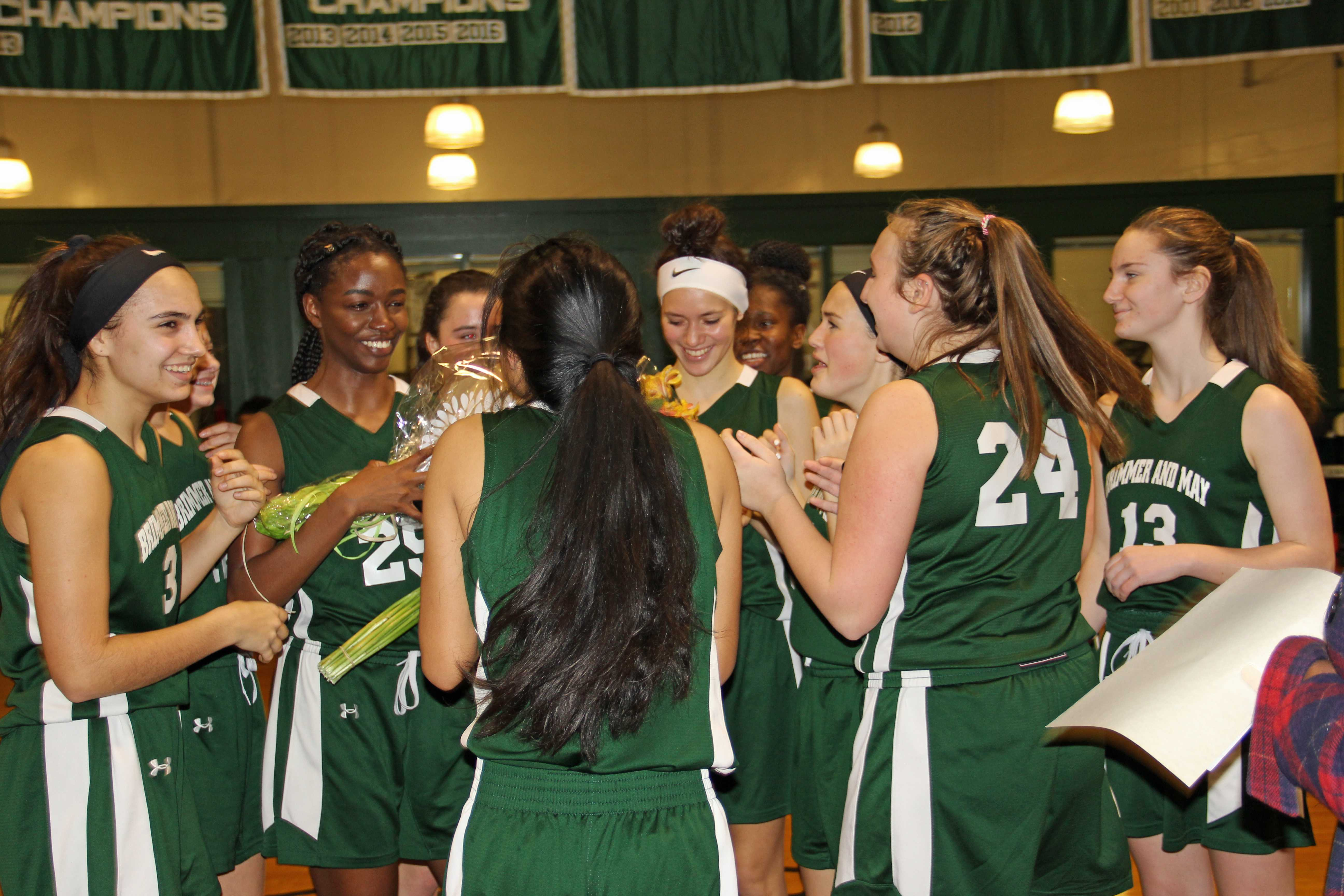 At her last home game, Amy Nwachukwu '18 celebrates with her team during halftime. Photo by David Cutler '02.