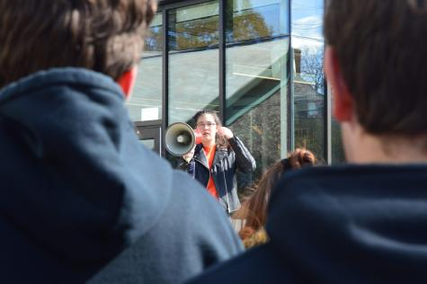 Last year, 'Radical Compassion' Co-Organizer Maya Bousek '19 encourages students to register to vote. Photo by Michelle Levinger '19.