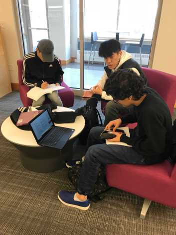 A group of students work on an assignment in the comfy new furniture (photo by Molly McHugh '21).