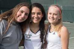 (L-R) Donna Columbo '19, Monica Morales '18, and Caroline Ellervik '18 share a pre-game pose. Photo by David Barron.
