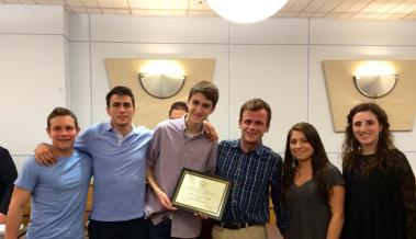 AJ Naddaff '15, second from left, poses with peers as the publication earns its first accolade at the Greater-Boston Scholastic News Competition in 2015.