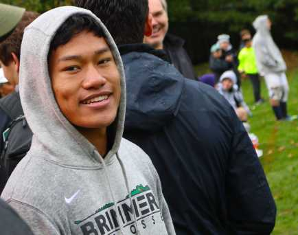 Henry Ngo '19 tries to warm up after his game and supports the girls. Photo by Michelle Levinger '19.