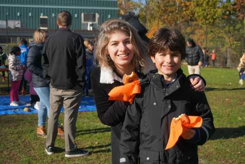 Michelle Levinger '19 poses with her Lower School buddy during Harvest Fest. Photo by Nicole DeCesare.