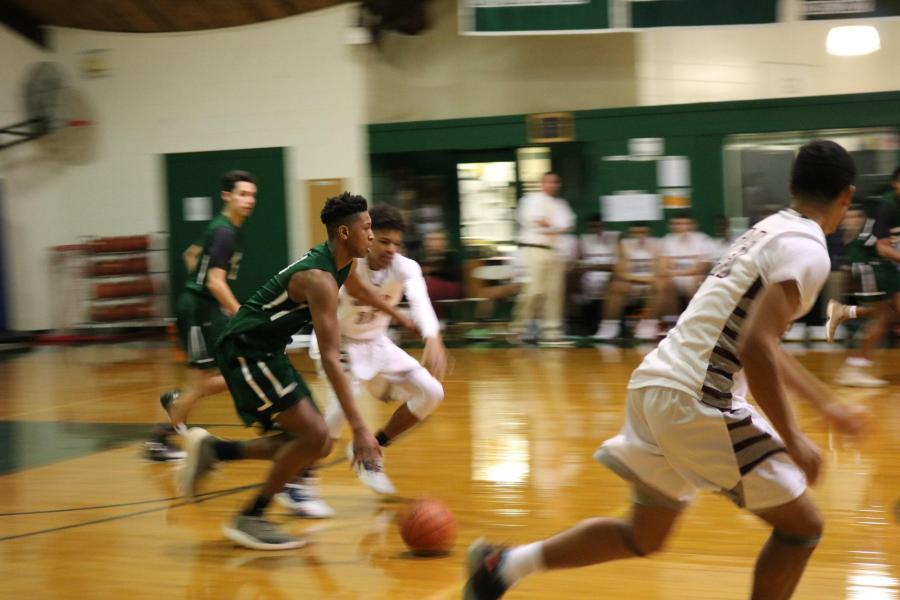 Gianni Thompson '21 dribbling up the court. Photo by Michelle Levinger '19.