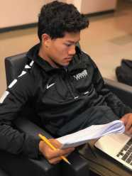Henry Ngo '19 working on his AP Biology homework. Photo By Sita Alomran '19.