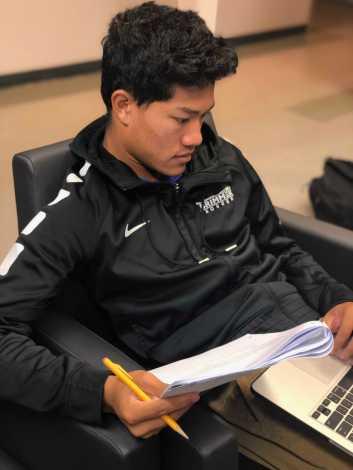 Henry Ngo '19 working on his AP Biology homework. Photo By Sita Alomran '19.