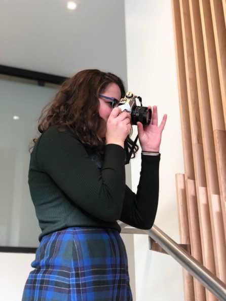 Catherine Leeder '20 taking pictures for photography class. Photo By Sita Alomran '19.
