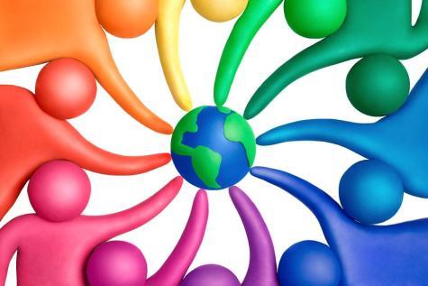 Multicolored plasticine human figures around a globe