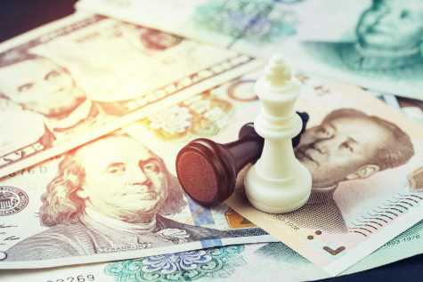 US and China finance tariff trade war concept, black loser and white winner chess king on US dollar and china yuan banknotes, world major market countries, import and export barrier. Purchased from BigStock.com.