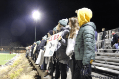 Students show their school spirit during the game. Photo by David Cutler.