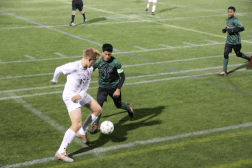 Henry Ngo '19 breaks a play. Photo by David Cutler.