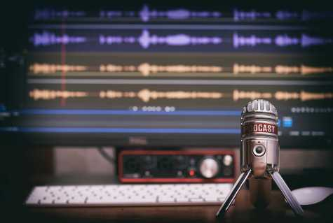 microphone with a podcast icon on a table