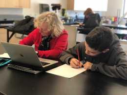 Nancy Bradley helping out a Middle schooler. Photo by Sita Alomran '19.