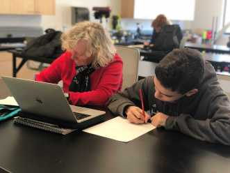 Nancy Bradley helping out a Middle schooler. Photo by Sita Alomran '19.