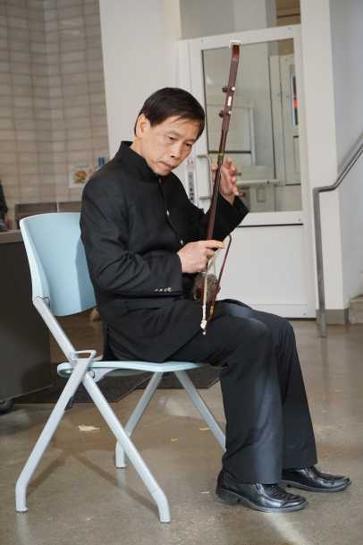 Students enjoy traditional Chinese music on the Er Hu from a Tai Chi master.