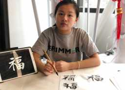 Middle Schooler in charge of calligraphy. Photo By Sita Alomran '19.