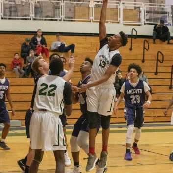 Gianni Thompson '21 going for a layup against Andover at Babson. Photo by David Barron.