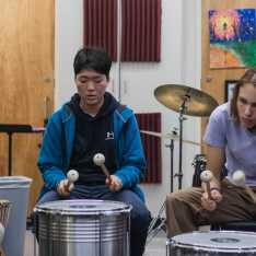 Ray Park and Dieter Gartner '22 play drums in Ensemble.