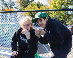 Freshmen Brian Gamble and Nico Jaffer enjoy hamburgers and hotdogs at halftime.