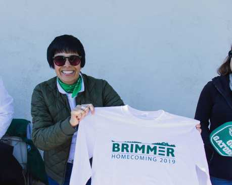 Sharin Russell hands out T-Shirts to the first 250 spectators through the doors.
