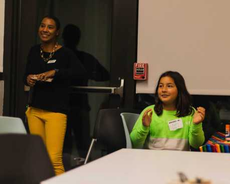 Jessica Christian and Nydia Comenzo '27 clap for a parent presenter.
