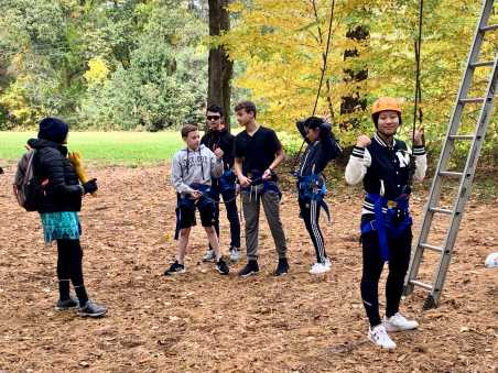 Hebe Qiang '23 gets ready to do the ropes course. Photo by Edan Zinn ''23.