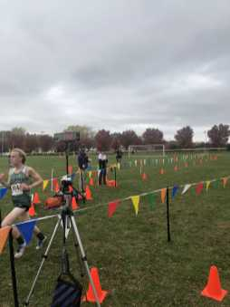 Brian Gamble '23 crosses the finish first overall, winning the MBIL Championship, defeating 110 other runners. ``