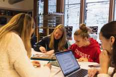 Kate Hirschen '23, Alison Rimas '23, Eleanor Reyelt '23, and Natalie Kozhemiakin '23 sketch their final projects in Drawing I.