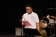 Enyinna Adiele '24 introduces the 8th Grade Band.
