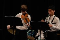 "8th Graders in Band play the violin and saxophone to ""Giorno's Theme"" (from ""Jojo's Bizarre Adventure"")."